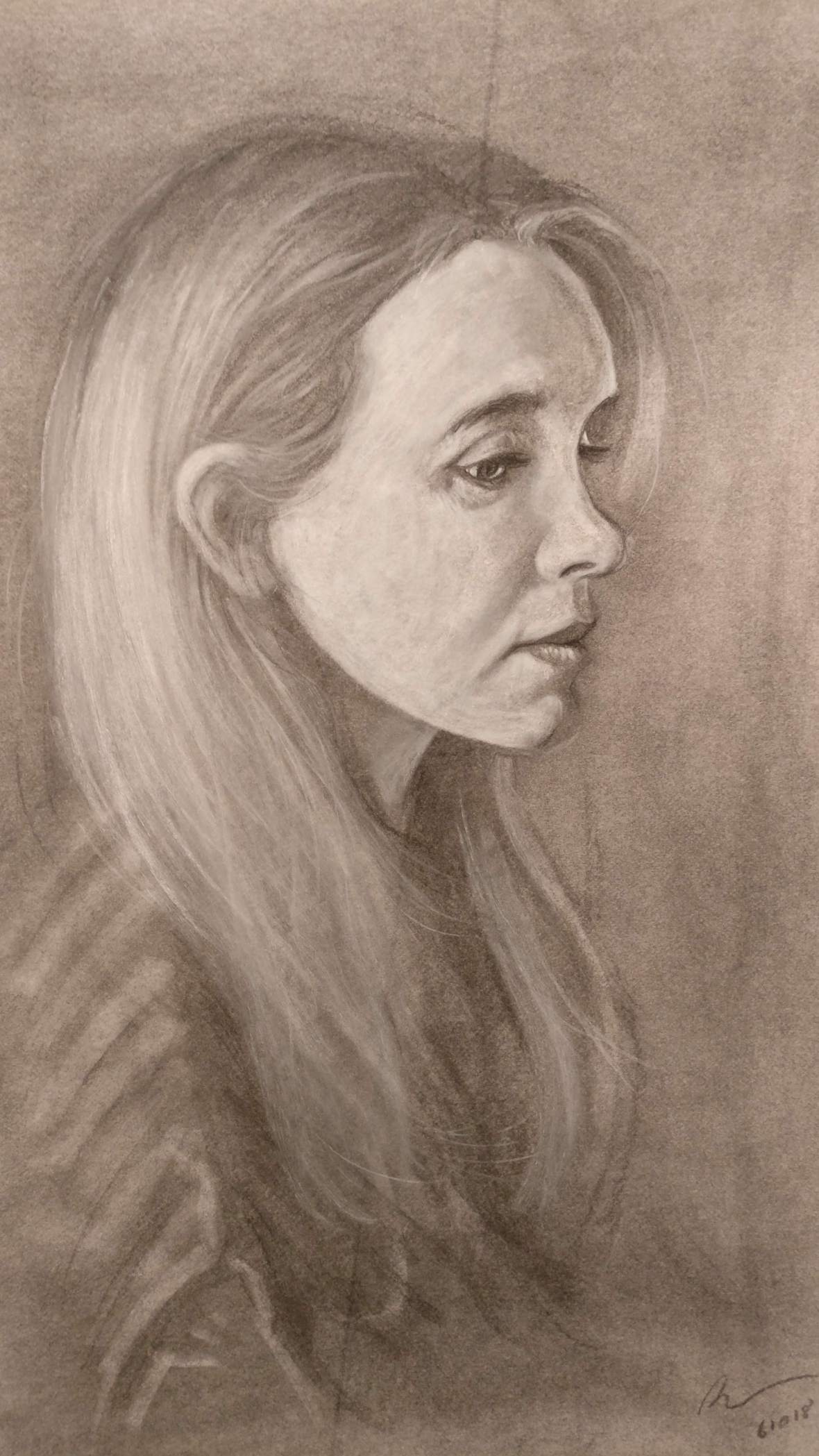charcoal portrait of a girl's profile