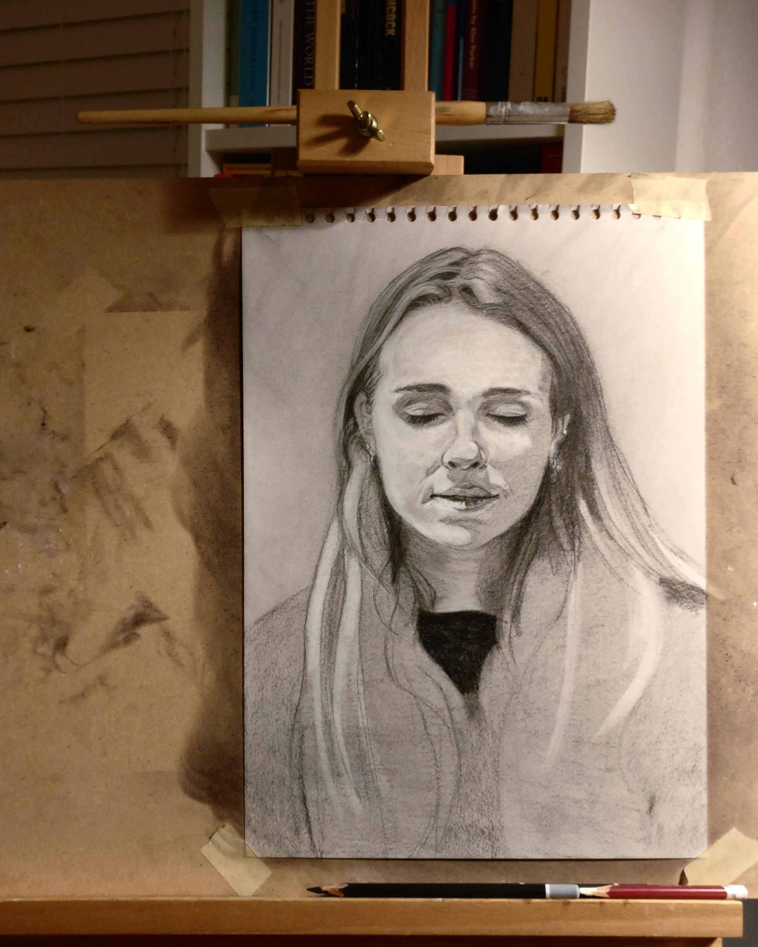 Charcoal drawing on an easel
