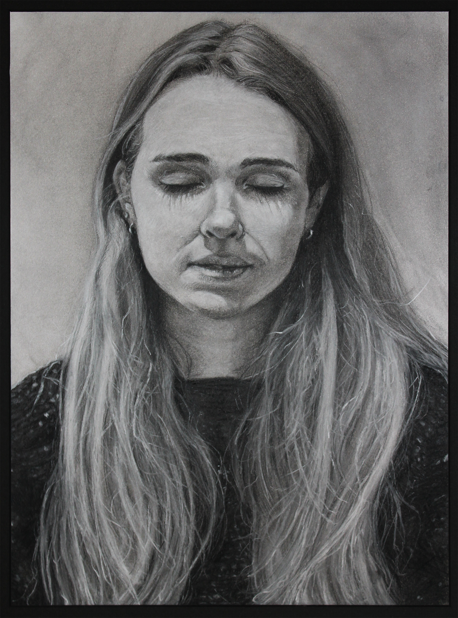 charcoal portrait of a woman with her eyes closed