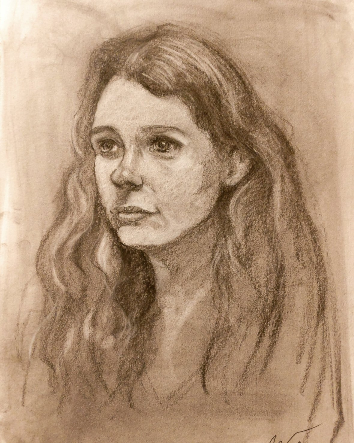 Charcoal drawing of a young lady with long curly hair