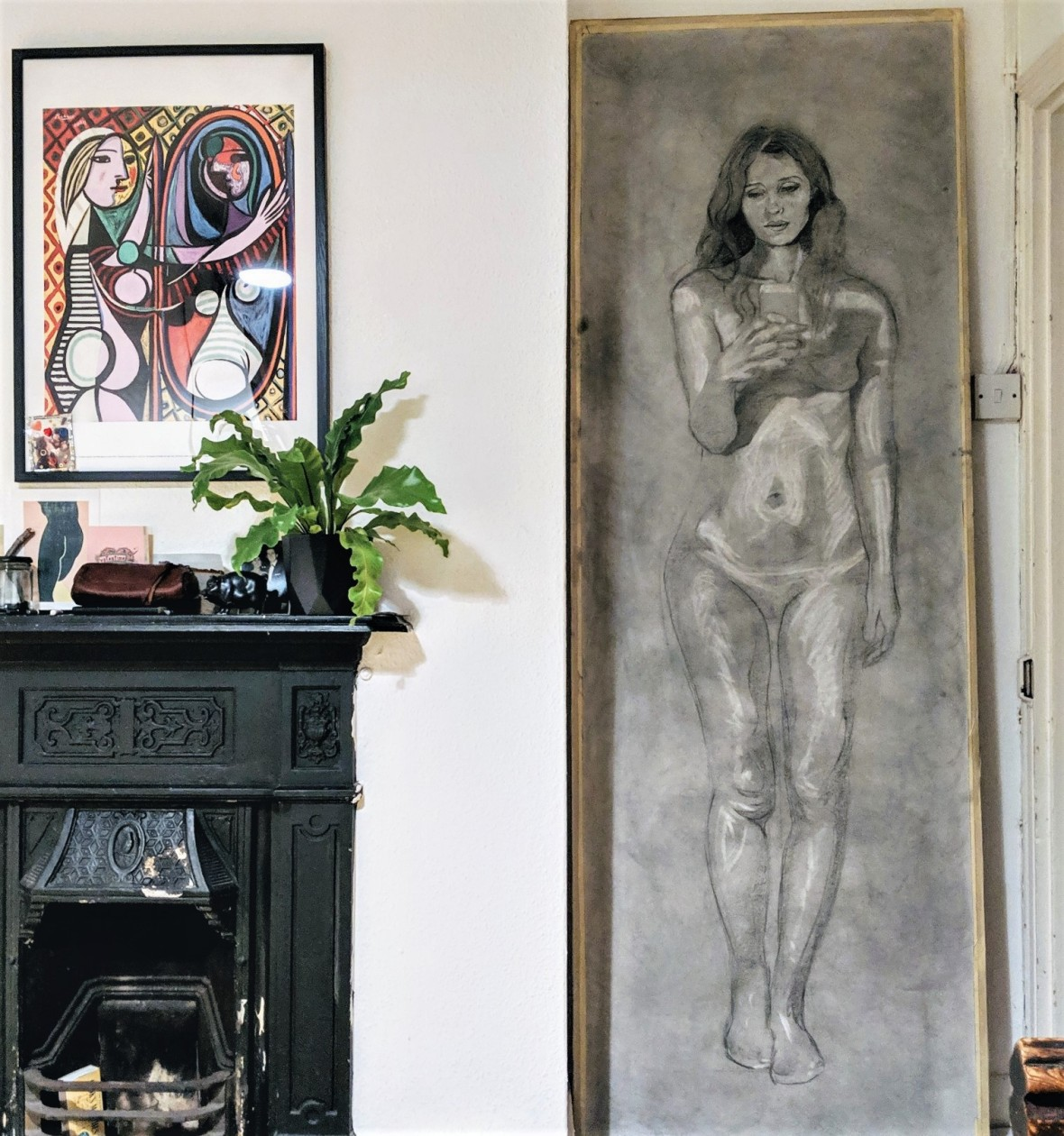 The incomplete life-size drawing of Eve stands up against the studio wall