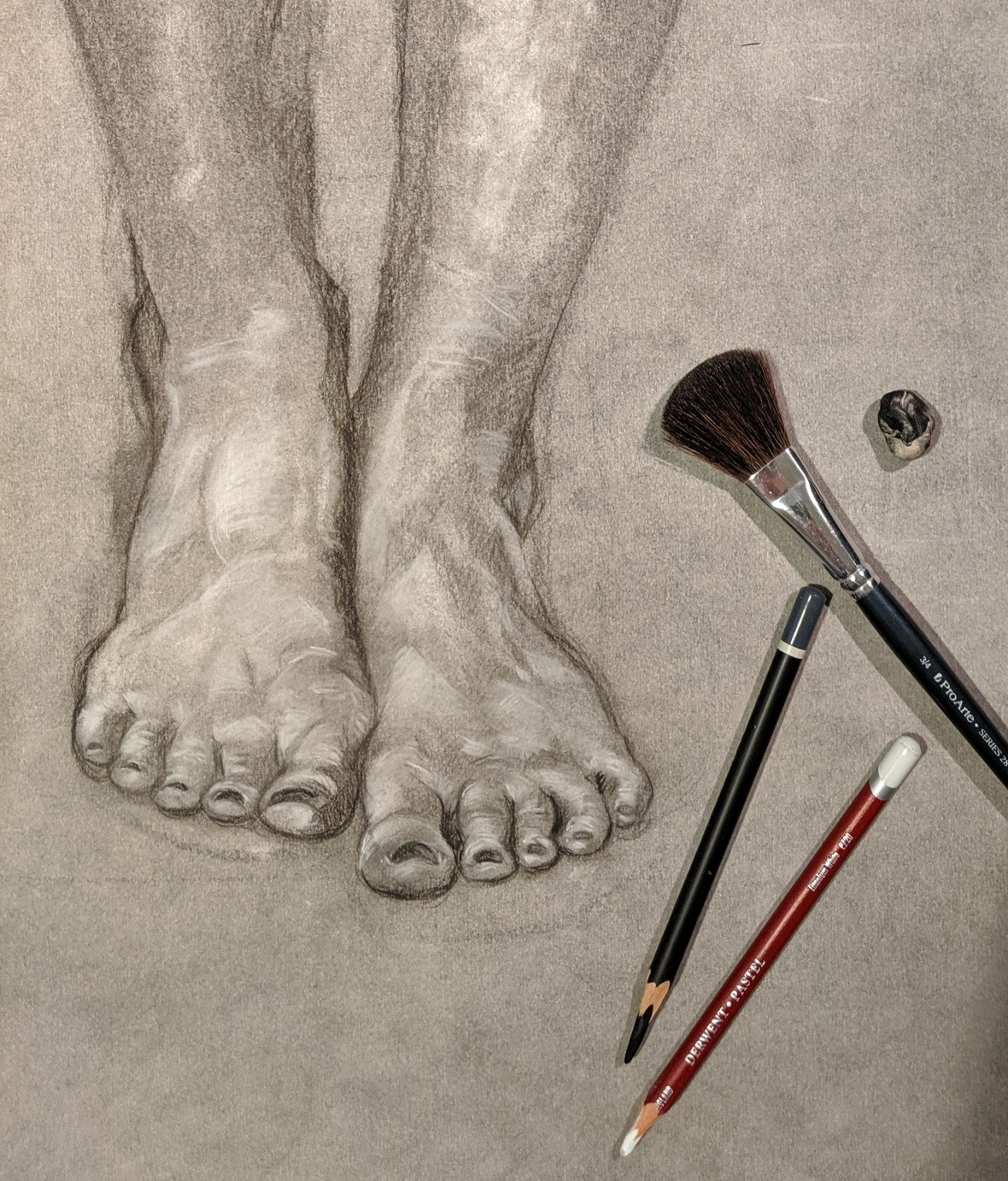 A charcoal drawing of feet