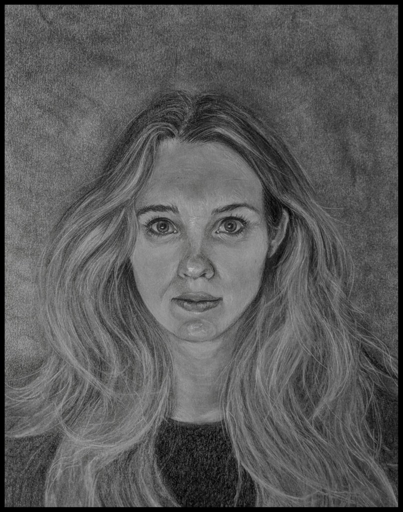 Charcoal portrait of a lady with long flowing hair