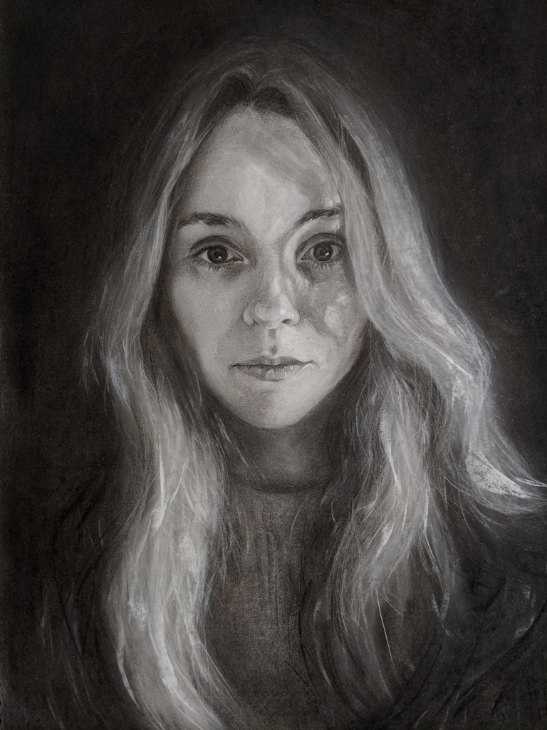 A black and white drawing of a portrait of a young lady with long hair. The face is illuminated within the darkness, as if in a spotlight
